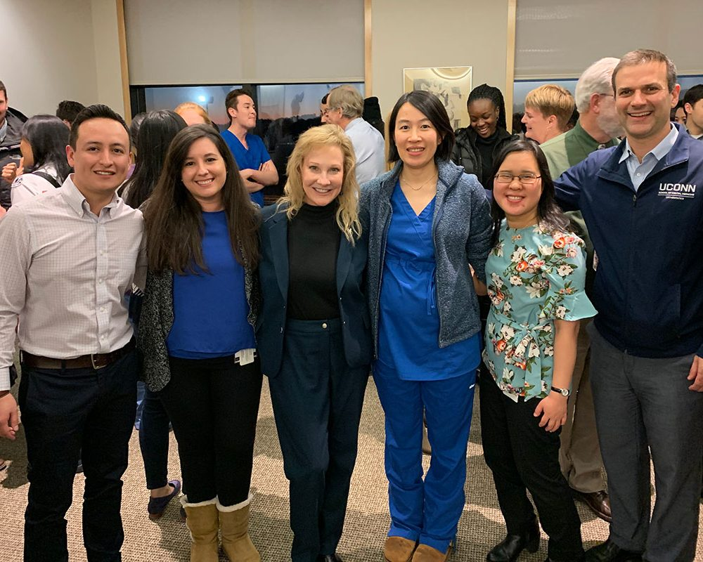 Dr. Sharon Gordon, dean of the UConn School of Dental Medicine (third from left) celebrates the Class of 2019's match, her first match since joining UConn, with students (from left) Willan Jumbo, Sharon Vincenty-Flores, Xiaomu (Michelle) Guan, and Victoria Phu, and Dr. Flavio Uribe. (Photo by Dr. Sarita Arteaga)