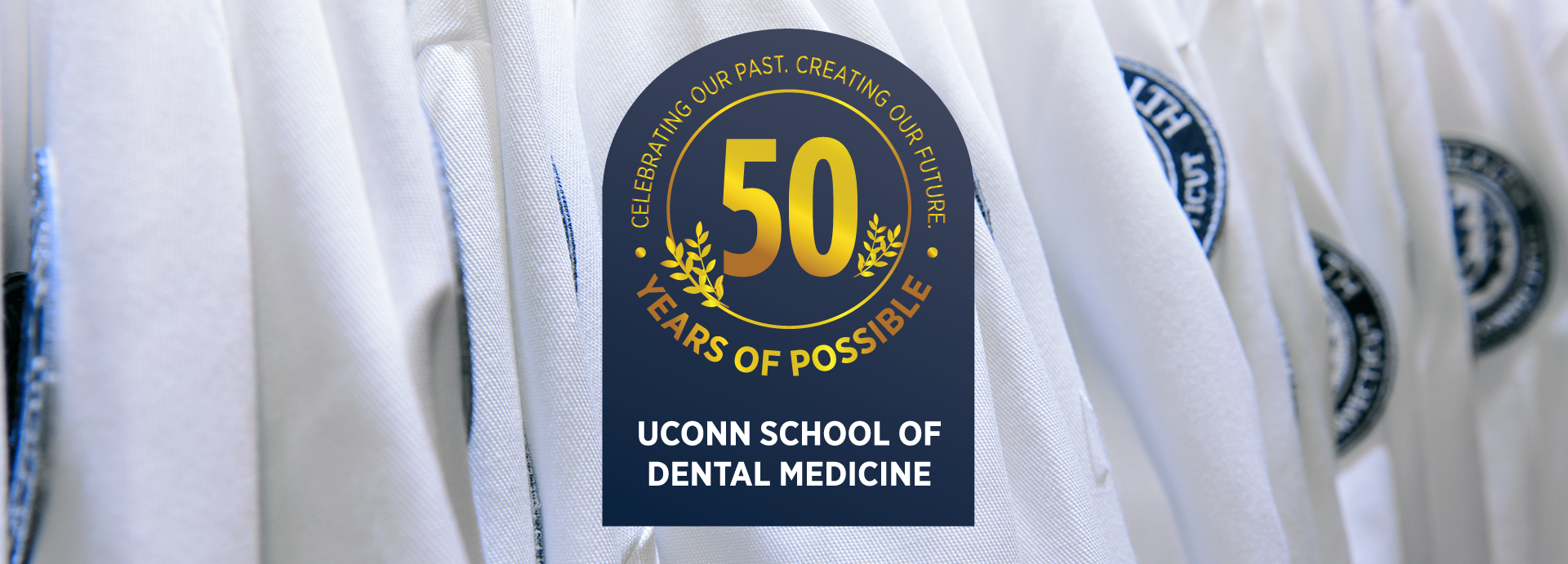 UConn School of Medicine 50 Years of Possible Seal overtop white coats
